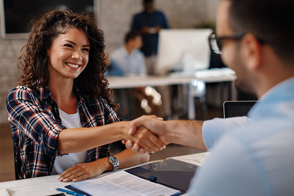 Woman signing new hire contract